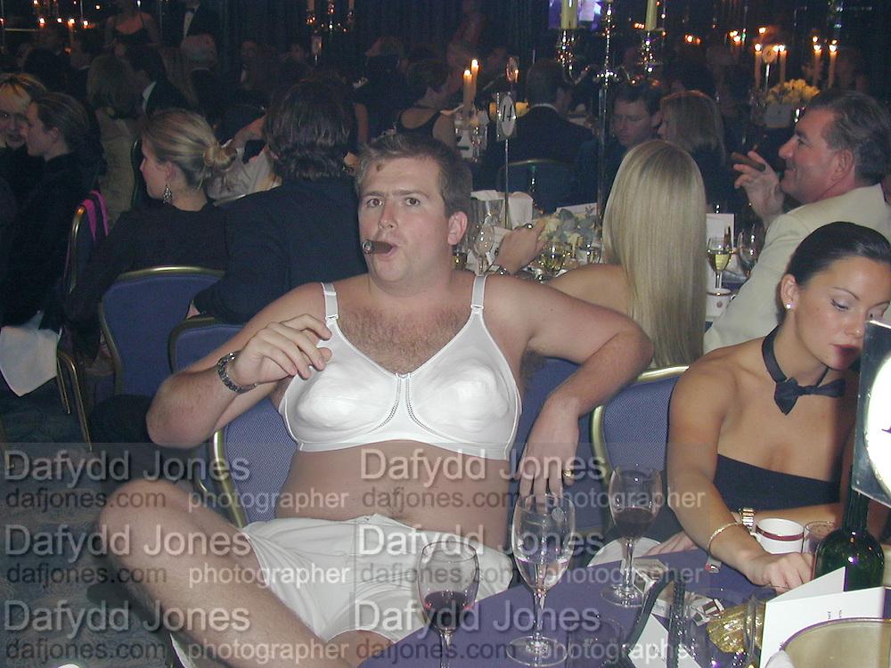 Rory Gordon and Natalie Jones. James Bond charity Ball in aid of Baby Lifeline. Dorchester. 30 October 2000.  © Copyright Photograph by Dafydd Jones 66 Stockwell Park Rd. London SW9 0DA Tel 020 7733 0108 www.dafjones.com