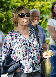 June 16, 2017 - London, London, UK - LONDON, UK.  A woman holds a candle at The Great Get Together. Neighbours and friends of Jo Cox attend The Great Get Together near Hermitage Moorings in Wapping to pay tribute and celebrate Jo's call that more unites us than divides us on the anniversary of her death. Jo Cox lived on a house boat in Wapping with her husband Brendan Cox and two children. (Credit Image: © Vickie Flores/London News Pictures via ZUMA Wire)