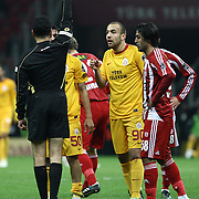 Referee's Bulent Yildirim show the red card to Galatasaray's Engin Baytar (R) during their Turkish Superleague soccer match Galatasaray between Sivasspor at the Turk Telekom Arena at Aslantepe in Istanbul Turkey on Saturday 26 November 2011. Photo by TURKPIX