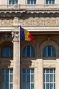 Romain Flag outside the Palace of the Parliament (Also known as Ceausescu's Palace or House of The People) in Bucharest, Romania. Built 1983-1989. Architect: Anca Petrescu