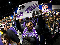 Dec 31, 2014; Atlanta , GA, USA; TCU Horned Frogs fans greet players prior to the game against the Mississippi Rebels in the 2014 Peach Bowl at the Georgia Dome. Mandatory Credit: Paul Abell/CFA Peach Bowl via USA TODAY Sports