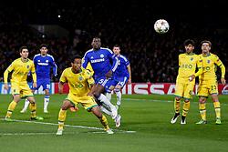 Joao Mario of Sporting is challenged by Kurt Zouma of Chelsea - Photo mandatory by-line: Rogan Thomson/JMP - 07966 386802 - 10/12/2014 - SPORT - FOOTBALL - London, England - Stamford Bridge - Sporting Clube de Portugal - UEFA Champions League Group G.