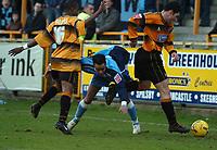 Photo: Ian Hebden.<br />Boston United v Wycombe Wanderers. Coca Cola League 2. 18/02/2006.<br />Boston's Danny Thomas (L) and Austin McCann (R) stop Wycombe's Danny Senda (C).