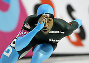 Shani Davis of the USA competes in the men's 1500 meter World Cup speed skating competition at the Utah Olympic Oval in Kearns, Utah, Friday, Feb. 18, 2011. Davis won a bronze medal in the event. (AP Photo/Colin E Braley)
