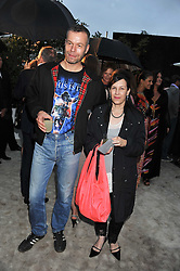 Wolfgang Tillmans and Maureen Paley at the annual Serpentine Gallery Summer Party sponsored by Burberry held at the Serpentine Gallery, Kensington Gardens, London on 28th June 2011.