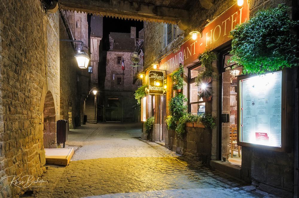 La Confiance Restaurant and cobblestone street at night, Mont Saint-Michel, Normandy, France