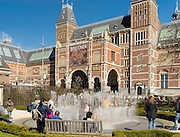 People gather outside Amsterdam's RIjksmuseum on a beautiful spring day.