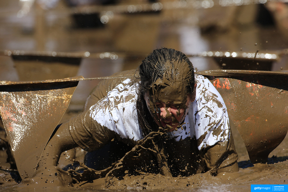 Expressions of young competitors as they tackle the mud pit during the New York Merrell Down and Dirty Obstacle Race presented by Subaru. Over 6000 competitors took part in the event which included mud pits, water crossings, slippery mountain, cargo nets, monster climb and ladder walls. The event was held at Pelham Bay Park The Bronx, New York. 29th September 2013. Photo Tim Clayton