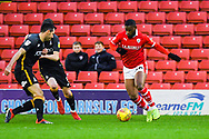 Mamadou Thiam of Barnsley (26) takes on his markers during the EFL Sky Bet League 1 match between Barnsley and Bradford City at Oakwell, Barnsley, England on 12 January 2019.