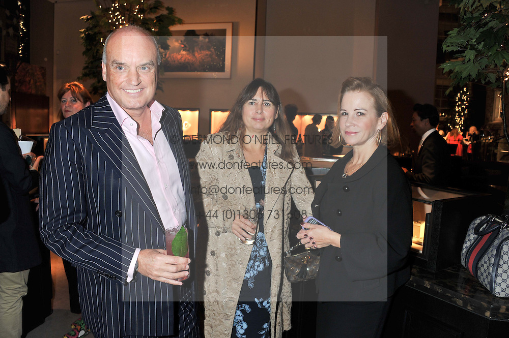 Left to right, NICHOLAS COLERIDGE, ALEXANDRA SHULMAN and GERRI GALLAGHER at a party to celebrate the launch of Carol Woolton's book 'Drawing Jewels For Fashion' held at Asprey, 167 New Bond Street, London W1 on 10th November 2011.