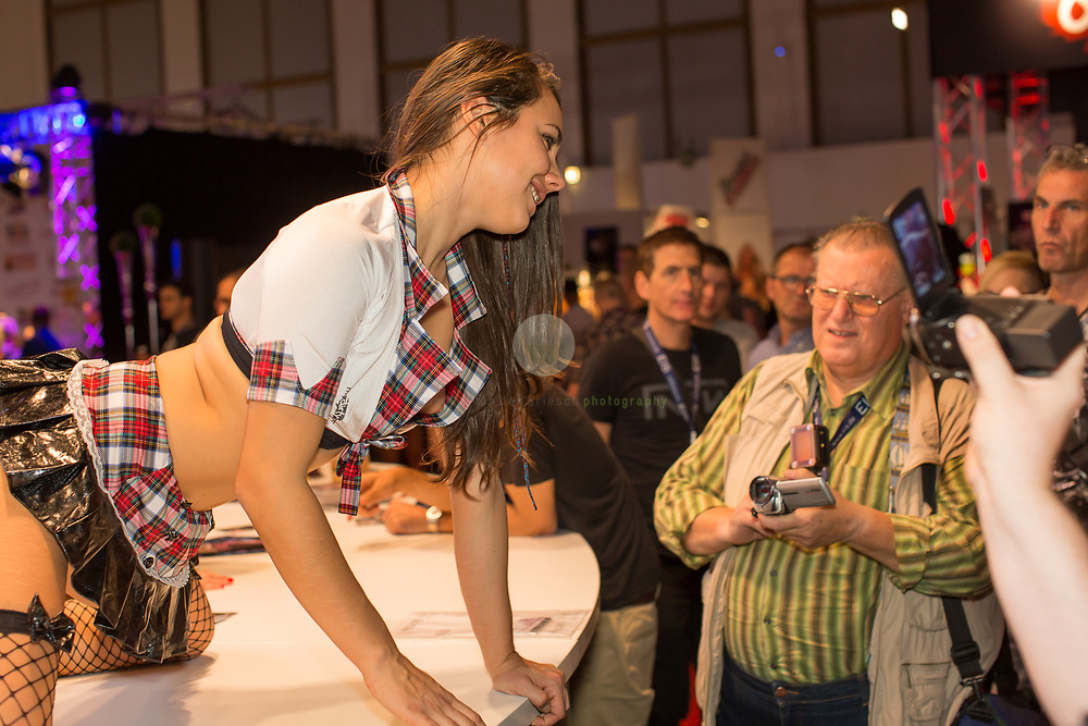 Berlin Expo Center, Berlin, GERMANY, 12.10.2018 - A porno actress meeting their fans. The VENUS Berlin Fair is among the largest international erotic trade fairs, with more than 250 exhibitions from 40 countries and 30,000 visitors.<br /> <br /> Messegelaende unterm Funkturm, Berlin. 12.10.2018. VENUS 2018: Eine Pornodarstellerin am Stand von My Dirty Hobby.