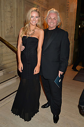 KIMBERLEY GARNER and DAVID EMANUEL at the opening night of Cirque du Soleil's award-winning production of Quidam at the Royal Albert Hall, London on 7th January 2014.