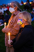 20 SEPTEMBER 2020 - DES MOINES, IOWA: A couple with candles at a vigil for US Supreme Court Justice Ruth Bader Ginsburg in Poppajohn Sculpture Park in Des Moines. About 200 people attended the candlelight vigil for Justice Ruth Bader Ginsburg. Ginsburg died from pancreatic cancer on September 18, 2020.       PHOTO BY JACK KURTZ