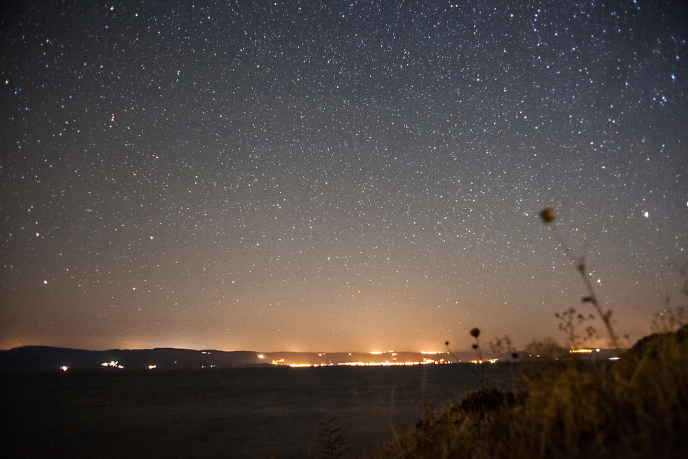 Lights on the Turkish coast line as seen from northern Lesvos. After Turkey started to enforce departures towards the Island, few to no landings have been reported, a small family here, one or two men there, arrive with smugglers' speed boats.