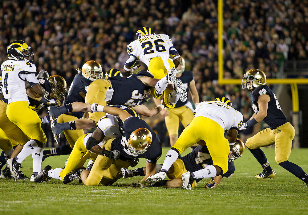 September 22, 2012:  Michigan running back Dennis Norfleet (26) attempt to leap over pile on kick return during NCAA Football game action between the Notre Dame Fighting Irish and the Michigan Wolverines at Notre Dame Stadium in South Bend, Indiana.  Notre Dame defeated Michigan 13-6.