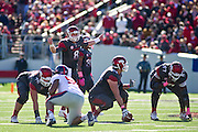 Oct 27, 2012; Little Rock, AR, USA; Arkansas Razorback quarterback Tyler Wilson (8) calls a play as offensive linemen A.J. Hawkins (76) and Chris Gill (67) and center Travis Swanson (64) line up during a game against the Ole Miss Rebels at War Memorial Stadium. Ole Miss defeated Arkansas 30-27. Mandatory Credit: Beth Hall-US PRESSWIRE