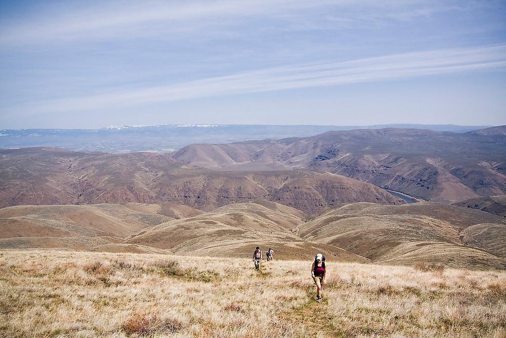 Hikers explore the dry hills of Umtanum Ridge, Umtanum Creek Recreation Area near Yakima, Washington.