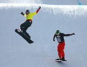 SHOT 1/26/08 2:28:42 PM - Markus Schairer (left) of St. Gallenkirch, Austria tries to regain his balance just before crashing over the final jump on the Snowboarder X course as Nate Holland (right) of Truckee, Ca. cruises past him to take home the gold medal during the finals of the event on Saturday January 26, 2008 at Winter X Games Twelve in Aspen, Co. at Buttermilk Mountain. The 12th annual winter action sports competition features athletes from across the globe competing for medals and prize money is skiing, snowboarding and snowmobile. Numerous events were broadcast live and seen in more than 120 countries. The event will remain in Aspen, Co. through 2010..(Photo by Marc Piscotty / © 2008)