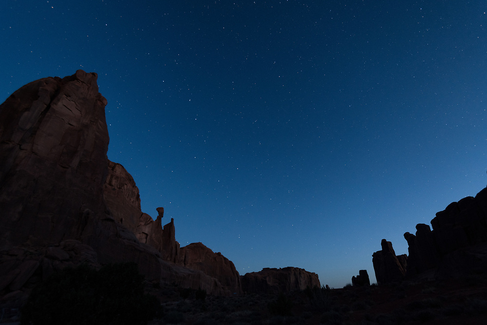 Ursa Major, the Big Dipper, over a formation known as Park City in Arches National Park
