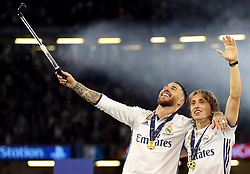 Real Madrid's Sergio Ramo and Luke Modric celebrate after the final whistle