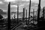 Residents walk amongst the burnt out remains of shacks that were destroyed by a fire in the northern part of Sao Paulo.More than 2 million people live in precarious communities like this one in Sao Paulo, mostly without access to water and sewage.