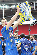 Paul Robinson defender for AFC Wimbledon (6) lifting the trophy. AFC Wimbledon promotion to League One, after beating Plymouth Argyle Football Club 2-0 during the Sky Bet League 2 play off final match between AFC Wimbledon and Plymouth Argyle at Wembley Stadium, London, England on 30 May 2016. Photo by Stuart Butcher.