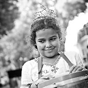 Young girl playing drums at street festival