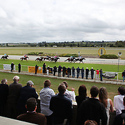 Spectators watch the race finish during a day at the Races at the Gore Race Meeting, Gore, Southland, New Zealand. 18th December 2011. Photo Tim Clayton