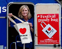 Edinburgh, Scotland, UK. 2 August, 2018. Kiosk operated by The Scotsman newspaper selling Edinburgh Festival goodie bags containing guides, reviews and ticket offers to the festival.