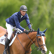 Charles Jacobs riding Cassinja S in action during the $35,000 Grand Prix of North Salem presented by Karina Brez Jewelry during the Old Salem Farm Spring Horse Show, North Salem, New York, USA. 15th May 2015. Photo Tim Clayton