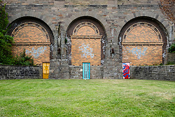 Street art project Openclose Dundee using art on doors in out of the way alleyways and lanes by local artists in the city. Dundee,Scotland, UK. Victoria Bridge Arches works L to R; Steph Liddle, Ryan McLeod, Zoe Gibson