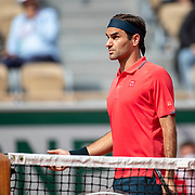 PARIS, FRANCE June 3. Roger Federer of Switzerland has an on court row with umpireEmmanuel Joseph during his match against Marin Cilic of Croatia on Court Philippe-Chatrier during the second round of the singles competition at the 2021 French Open Tennis Tournament at Roland Garros on June 3rd 2021 in Paris, France. (Photo by Tim Clayton/Corbis via Getty Images)