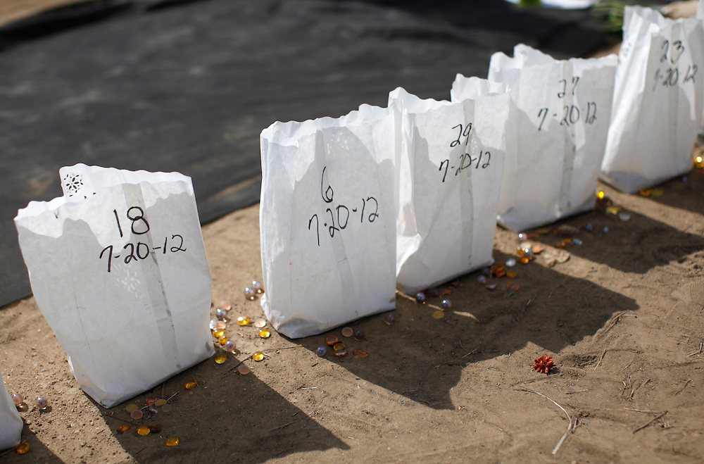 Bags containing candles shows the various ages of the victims including a 6-year-old at the memorial to the movie theater shooting victims in Aurora July 25, 2012. First responders got their first look at the growing memorial today.   REUTERS/Rick Wilking (UNITED STATES)