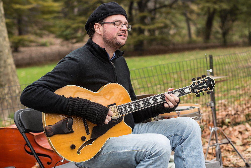 Doug Wamble plays guitar and sings.
