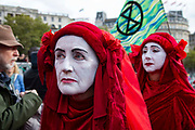 Extinction Rebellion climate activists art group The Red Brigade gather in Trafalgar Square despite the police imposing a section 14 of the Public Order Act 1986 order in effect banning all protest by the group in London.