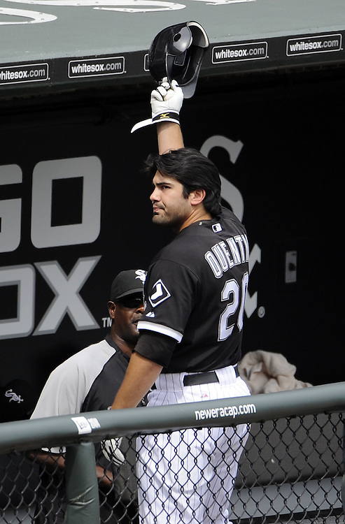 CHICAGO - JULY 11:  Carlos Quentin #20 of the Chicago White Sox acknowledges the fans by tipping his helmet after Quentin hit a grand slam home run in the sixth inning against the Kansas City Royals on July 11, 2010 at U.S. Cellular Field in Chicago, Illinois.  The White Sox defeated the Royals 15-5.  (Photo by Ron Vesely)