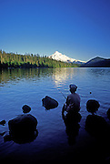 Image of a boy fishing at Lost Lake, Oregon, with Mount Hood in the background, Pacific Northwest by Randy Wells