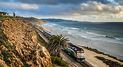 Train Passing Along The Coast Through Del Mar California