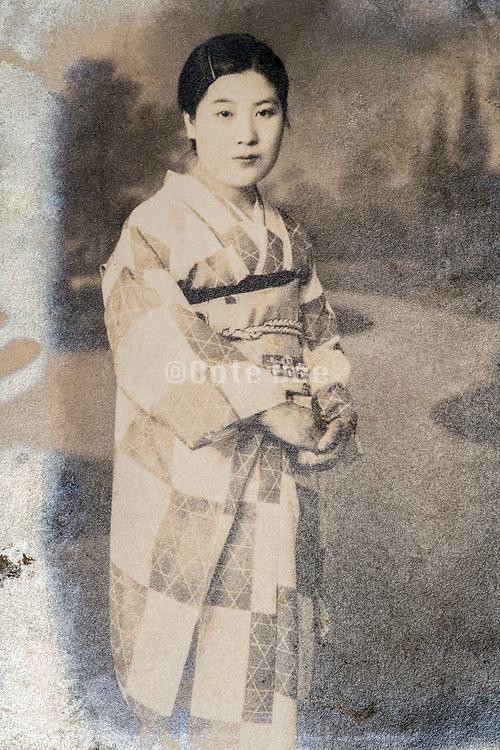 woman in traditional kimono clothing studio portrait ca 1930s Japan