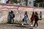 Red hearts that form the National Covid Memorial Wall, a tribute to the 150,000-plus British victims of the Coronavirus pandemic on 30th March 2021, in London, United Kingdom. Bereaved family and friends of Covid-19 victims have started working on the wall located outside St Thomas Hospital.