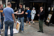 Londoners in the street with a life-size cardboard cut-out of Queen Elizabeth stands in the entrance of a pub in the City of London ahead of a weekend of nationwide celebrations for the monarch's Diamond Jubilee. A few months before the Olympics come to London, a multi-cultural UK is gearing up for a weekend and summer of pomp and patriotic fervour as their monarch celebrates 60 years on the throne and across Britain, flags and Union Jack bunting adorn towns and villages.