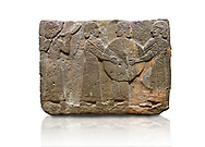 Hittite monumental relief sculpted orthostat stone panel of Procession. Basalt, Karkamıs, (Kargamıs), Carchemish (Karkemish), 900 - 700 B.C. Goddess Kubaba. Anatolian Civilisations Museum, Ankara, Turkey.<br /> <br /> Procession for. There are four figures on the other face of the orthostat. The leftmost figure plays a pipe, while the other three figures play the drums. All of the figures have long skirts and same body heights.  <br /> <br /> Against a white background. .<br />  <br /> If you prefer to buy from our ALAMY STOCK LIBRARY page at https://www.alamy.com/portfolio/paul-williams-funkystock/hittite-art-antiquities.html  - Type  Karkamıs in LOWER SEARCH WITHIN GALLERY box. Refine search by adding background colour, place, museum etc<br /> <br /> Visit our HITTITE PHOTO COLLECTIONS for more photos to download or buy as wall art prints https://funkystock.photoshelter.com/gallery-collection/The-Hittites-Art-Artefacts-Antiquities-Historic-Sites-Pictures-Images-of/C0000NUBSMhSc3Oo