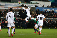 Luciano Narsingh of Swansea city falls over the top of Hal Robson-Kanu of West Bromwich Albion. Premier league match, Swansea city v West Bromwich Albion at the Liberty Stadium in Swansea, South Wales on Saturday 9th December 2017.<br /> pic by  Andrew Orchard, Andrew Orchard sports photography.