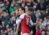 Football - 2018 / 2019 Premier League - Arsenal vs. Southampton<br /> Aaron Ramsey (Arsenal FC) and Mesut Ozil (Arsenal FC) pass each other as Aaron Ramsey (Arsenal FC) is taken off at The Emirates.<br /> <br /> COLORSPORT/DANIEL BEARHAM