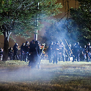 Charlotte, NC- September 22, 2016: Charlotte Mecklenburg police officers successfully push a group of demonstrators off interstate 277 using non-lethal rounds during a march through uptown Charlotte.  CREDIT: LOGAN R. CYRUS FOR THE NEW YORK TIMES