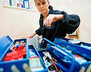 Plumber Pauline Brown in a flat conversion..Pauline Brown lies across the floor in a converted Hackney council flat bathroom.. tools, training, UK, water, women, women, work, work. .