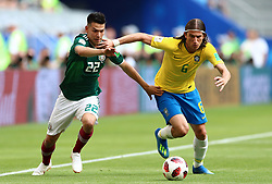 Mexico's Hugo Ayala (left) and Brazil's Filipe Luis battle for the ball