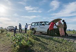 31 May 2019, Mokolo, Cameroon: LWF staff examine the car's engine along the road to Mokong, in the Mayo-Tsanaga department, far north region, Cameroon.