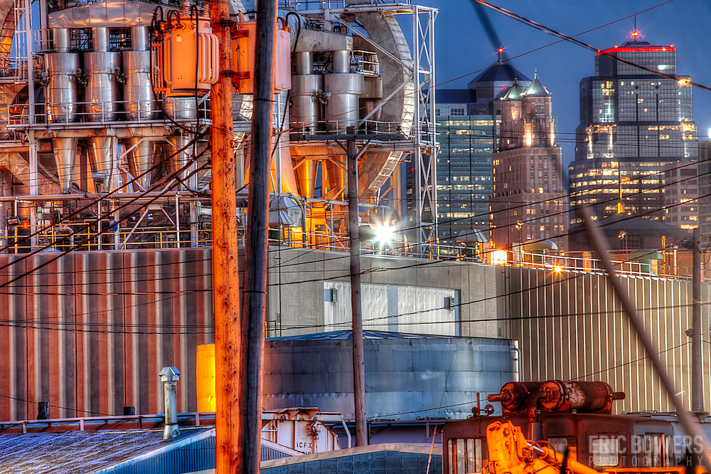 Kansas City MO Skyline with an industrial site in North Kansas City across the river in the foreground.