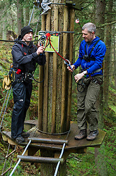 Pictured: Iain Roanaldson from Go Ape ensures that Willie Rennie is safe in the trees<br /> <br /> Scottish Liberal Democrat leader Willie Rennie joined South of Scotland Liberal Democrat candidate Jim Hume at Go Ape in Glentress Forest, near Peebles. During his visit to the forest, Mr Rennie set out Liberal Democrat plans to ensure that Scotland starts hitting our climate change targets. <br /> Ger Harley | EEm 4 April 2016